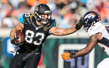 Ben Koyack, Corey Nelson. Jacksonville Jaguars tight end Ben Koyack (83) stiff-arms Denver Broncos inside linebacker Corey Nelson (52) during the second half of an NFL football game in Jacksonville, Fla