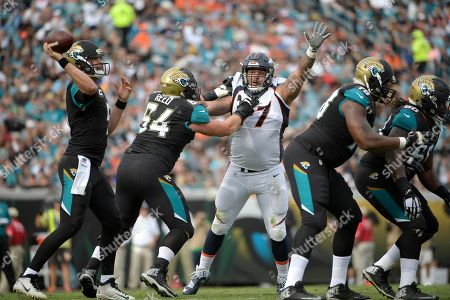 Jacksonville Jaguars quarterback Blake Bortles (5) throws a pass as guard Christopher Reed (64) blocks Denver Broncos defensive end Billy Winn (97) during the first half of an NFL football game in Jacksonville, Fla