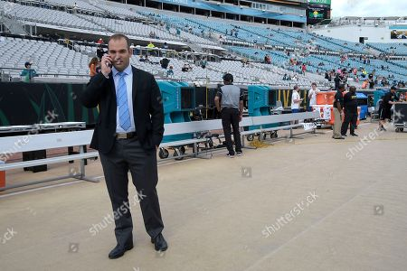 Jacksonville Jaguars general manager David Caldwell talks on his phone before an NFL football game against the Denver Broncos in Jacksonville, Fla
