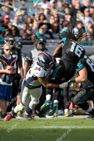 Stock Photo of Jacksonville Jaguars running back Denard Robinson (16) is tackled by Denver Broncos inside linebacker Brandon Marshall (54) after catching a pass during the second half of an NFL football game in Jacksonville, Fla., . The Broncos won 20-10