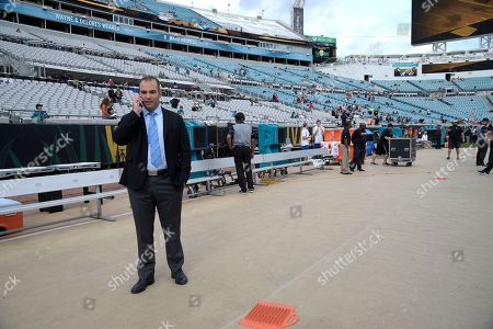 Jacksonville Jaguars general manager David Caldwell talks on his phone on the sideline during warmups before an NFL football game against the Denver Broncos in Jacksonville, Fla