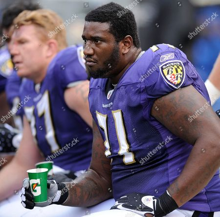 Baltimore Ravens offensive tackle Jared Gaither sits on the bench during the NFL football game against the Denver Broncos, in Baltimore
