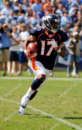 Denver Broncos wide receiver Quan Cosby runs the ball against the Tennessee Titansin the second quarter of an NFL football game, in Nashville, Tenn