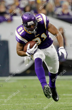 Minnesota Vikings' Visanthe Shiancoe runs during the first half of an NFL football game against the Denver Broncos, in Minneapolis