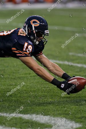Chicago Bears wide receiver Jimmy Young (19) recovers his own fumble after signaling a fair catch for a punt return in the first half an NFL preseason football game against Cleveland Browns in Chicago