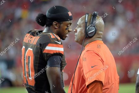 Hue Jackson, Robert Griffin III. Cleveland Browns head coach Hue Jackson, right, talks with quarterback Robert Griffin III (10) on the sideline during the first half of an NFL preseason football game against the Tampa Bay Buccaneers in Tampa, Fla