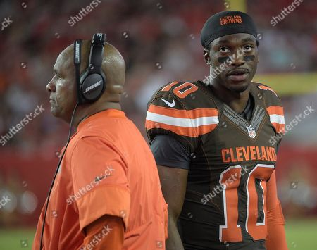 Cleveland Browns quarterback Robert Griffin III (10) walks behind head coach Hue Jackson during the first quarter of an NFL preseason football game, in Tampa, Fla