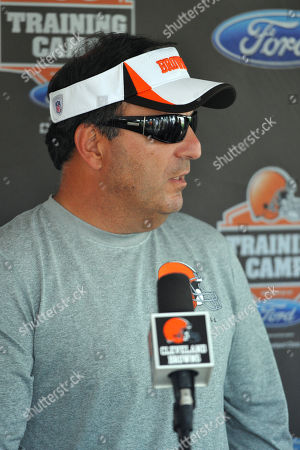 Cleveland Browns General Manager Mike Lombardi talks during practice at training camp at the NFL football team's facility in Berea, Ohio