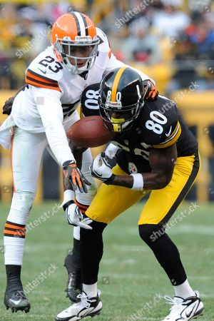 Plaxico Burress, Joe Haden. Pittsburgh Steelers wide receiver Plaxico Burress (80) can't make a catch as Cleveland Browns cornerback Joe Haden (23) defends in the fourth quarter of an NFL football game, in Pittsburgh