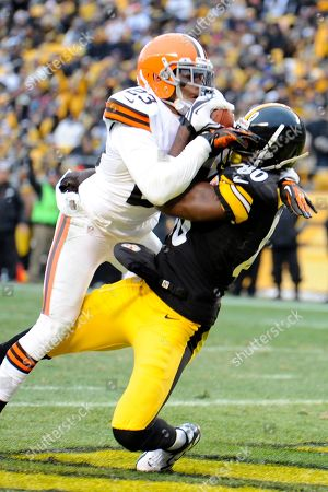 Joe Haden, Plaxico Burress. Pittsburgh Steelers wide receiver Plaxico Burress (80) makes a touchdown catch as Cleveland Browns cornerback Joe Haden (23) defends in the fourth quarter of an NFL football game, in Pittsburgh