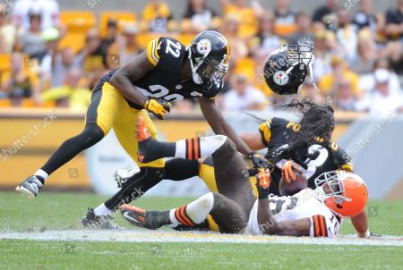 Troy Polamalu, Andrew Hawkins, William Gay. Pittsburgh Steelers strong safety Troy Polamalu (43) right, loses his helmet after makig a hit on Cleveland Browns wide receiver Andrew Hawkins (16) in the third quarter of the NFL football game on in Pittsburgh. Steelers cornerback William Gay (22) is at left