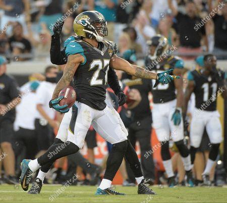 Jacksonville Jaguars cornerback Dwayne Gratz (27) celebrates an interception against the Tampa Bay Buccaneers during the first half of an NFL preseason football game in Jacksonville, Fla