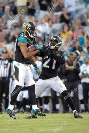 Dwayne Gratz, Prince Amukamara. Jacksonville Jaguars cornerback Dwayne Gratz (27) celebrates with defensive back Prince Amukamara (21) after making an interception during the first half of an NFL preseason football game against the Tampa Bay Buccaneers in Jacksonville, Fla