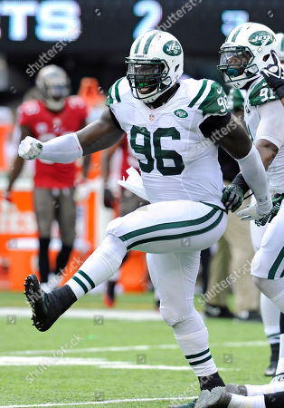 New York Jets linebacker Antwan Barnes (95) celebrates after the Jets scored on a safety against the Tampa Bay Buccaneers in the first half of an NFL football game, in East Rutherford, N.J