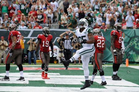 New York Jets linebacker Antwan Barnes (95) reacts after the Jets forced a safety score on the Tampa Bay Buccaneers in the first half of an NFL football game, in East Rutherford, N.J