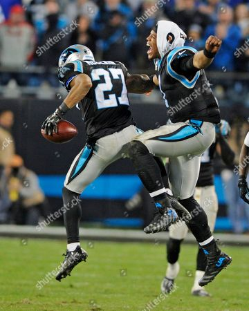 Cam Newton, Robert McClain. Carolina Panthers' Cam Newton (1) and Robert McClain (27) celebrate McClain's interception against the Tampa Bay Buccaneers in the second half of an NFL football game in Charlotte, N.C., . The Panthers won 38-10