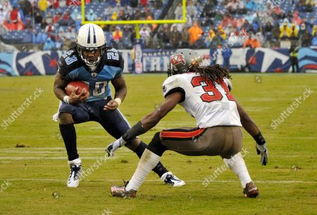 Chris Johnson, E. J. Biggers. Tennessee Titans running back Chris Johnson (28) runs against Tampa Bay Buccaneers defensive back E. J. Biggers (31) in the fourth quarter of an NFL football game, in Nashville, Tenn. The Titans won 23-17