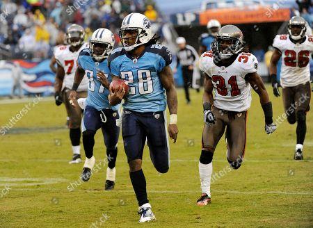 Chris Johnson, E. J. Biggers. Tennessee Titans running back Chris Johnson (28) runs ahead of Tampa Bay Buccaneers defender E. J. Biggers (31) in the fourth quarter of an NFL football game, in Nashville, Tenn. The Titans won 23-17