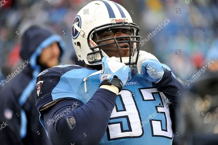 Tennessee Titans defensive tackle Shaun Smith pulls his helmet on in the fourth quarter of an NFL football game against the Tampa Bay Buccaneers, in Nashville, Tenn