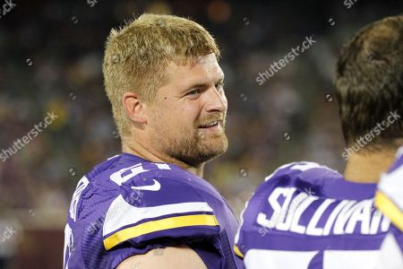 Minnesota Vikings center Joe Berger (61) talks with a teammate in the second half of a preseason NFL football game against the Tampa Bay Buccaneers at TCF Bank Stadium, in Minneapolis