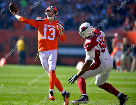 LaMarr Woodley, Josh McCown. Cleveland Browns quarterback Josh McCown (13) throws under pressure from Arizona Cardinals outside linebacker LaMarr Woodley (56) in the first half of an NFL football game, in Cleveland
