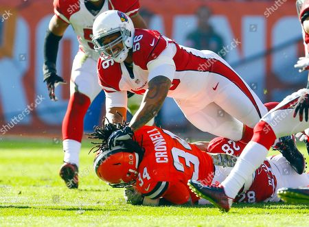 LaMarr Woodley, Isaiah Crowell. Arizona Cardinals outside linebacker LaMarr Woodley (56) brings down Cleveland Browns running back Isaiah Crowell (34) during an NFL football game, in Cleveland. Arizona won 34-20