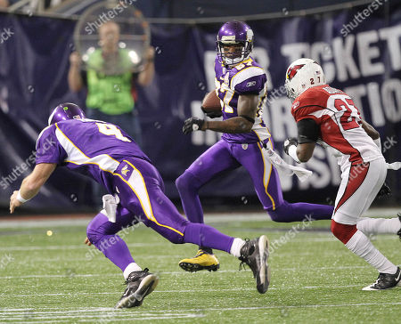 Bernard Berrian, Brett Favre, Michael Adams. Minnesota Vikings wide receiver Bernard Berrian (87) runs after a catch while Vikings quarterback Brett Favre (4) attempts a block on Arizona Cardinals cornerback Michael Adams (27) during an NFL football game in Minneapolis