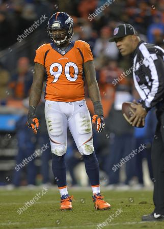 Denver Broncos defensive end Shaun Phillips (90) looks on between plays against the San Diego Chargers in the fourth quarter of an NFL AFC division playoff football game, in Denver