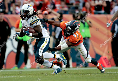 San Diego Chargers running back Melvin Gordon (28) eludes the reach of Denver Broncos outside linebacker Corey Nelson (52) after an NFL football game, in Denver. The Broncos won 27-19