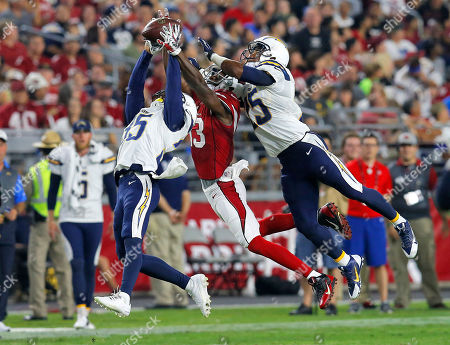Jaron Brown, Richard Crawford, Darrell Stuckey. Arizona Cardinals wide receiver Jaron Brown (13) can't hold on to a pass as San Diego Chargers' Richard Crawford, left, and Darrell Stuckey defend during the first half of an NFL preseason football game, in Glendale, Ariz