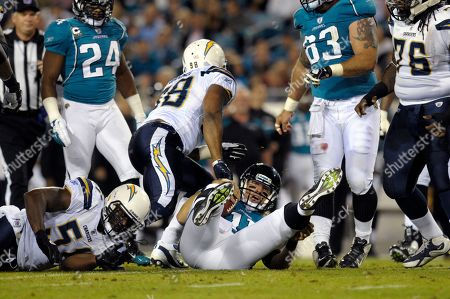 Takeo Spikes, Antwan Barnes, Blaine Gabbert. Jacksonville Jaguars quarterback Blaine Gabbert (11), center, reacts after being sacked by San Diego Chargers inside linebacker Takeo Spikes (51), left, and outside linebacker Antwan Barnes (98) during the first half of an NFL football game in Jacksonville, Fla