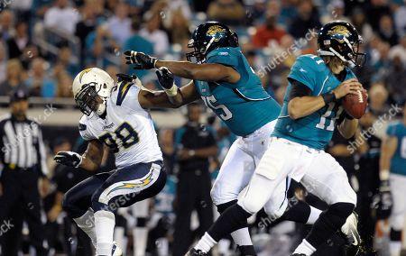 Blaine Gabbert, Eugene Monroe, Antwan Barnes. Jacksonville Jaguars quarterback Blaine Gabbert (11), right, looks for an open receiver as offensive tackle Eugene Monroe (75), center, applies a block on San Diego Chargers outside linebacker Antwan Barnes (98) during the second half of an NFL football game in Jacksonville, Fla