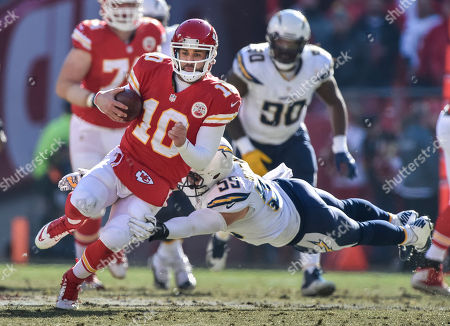 Chase Daniel, Andrew Gachkar. Kansas City Chiefs quarterback Chase Daniel (10) is tackled by San Diego Chargers inside linebacker Andrew Gachkar (59) during the first half of their NFL football game in Kansas City, Mo