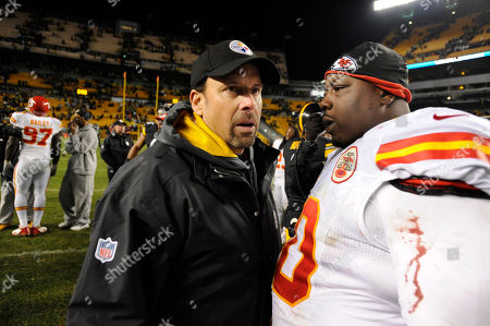Todd Haley, Shaun Smith. Pittsburgh Steelers offensive coordinator Todd Haley talks with Kansas City Chiefs defensive tackle Shaun Smith (90) following an NFL football game, in Pittsburgh. Pittsburgh won 16-13 in overtime