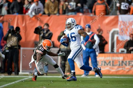 Indianapolis Colts' Josh Cribbs (16) runs past Cleveland Browns' Marlon Moore (15) on a kick return in the second quarter of an NFL football game, in Cleveland