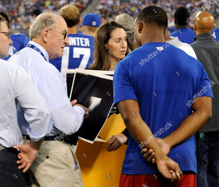 Russell Warren, Victor Cruz. Dr. Russell Warren, left, shows New York Giants wide receiver Victor Cruz his x-rays after Cruz was injured during the first half of an NFL preseason football game against the Indianapolis Colts, in East Rutherford, N.J