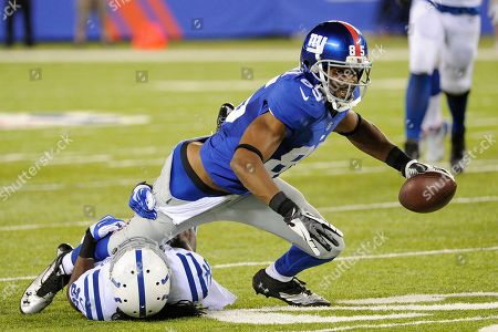 Stock Photo of Ramses Barden, Marshay Green. New York Giants wide receiver Ramses Barden (85) is tackled by Indianapolis Colts defensive back Marshay Green (25) during the first half of an NFL preseason football game, in East Rutherford, N.J