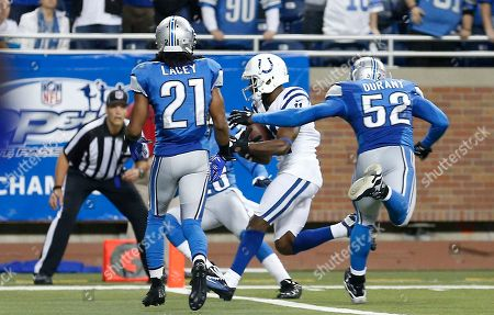 Indianapolis Colts wide receiver Donnie Avery (11), chased by Detroit Lions outside linebacker Justin Durant (52) and cornerback Jacob Lacey (21) runs into the end zone for a touchdown with no time remaining in the fourth quarter of an NFL football game at Ford Field in Detroit