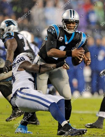 Cam Newton, Robert Mathis. Carolina Panthers' Cam Newton (1) is sacked by Indianapolis Colts' Robert Mathis (98) in the second half of an NFL football game in Charlotte, N.C