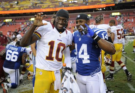 Stock Picture of Washington Redskins quarterback Robert Griffin III (10) poses for photographers with Indianapolis Colts wide receiver Quan Cosby (14) after a preseason NFL football game, in Landover, Md