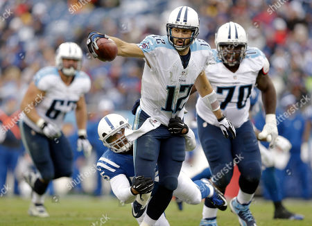 Stock Picture of Charlie Whitehurst, Shaun Phillips. Tennessee Titans quarterback Charlie Whitehurst (12) is brought down by Indianapolis Colts outside linebacker Shaun Phillips (55) while scrambling for a 3-yard gain in the first half of an NFL football game, in Nashville, Tenn