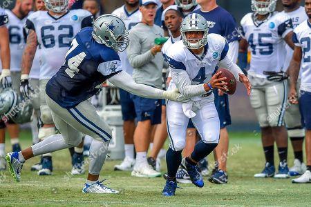 Lawrence Okoye, Dak Prescott. Dallas Cowboys defensive end Lawrence Okoye (74) rushes quarterback Dak Prescott (4) as he attempts to get a pass off during Dallas Cowboys' NFL football training camp, in Oxnard, Calif
