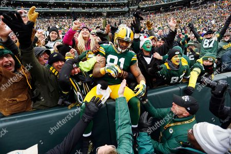 Green Bay Packers tight end Andrew Quarless (81) celebrates his touchdown against the Dallas Cowboys during the first half of an NFL divisional playoff football game, in Green Bay, Wis