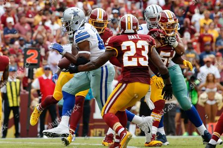 Albert Morris, DeAngelo Hall. Dallas Cowboys running back Albert Morris (46) carries the ball into the end zone for a touchdown past Washington Redskins free safety DeAngelo Hall (23) during the second half of an NFL football game in Landover, Md