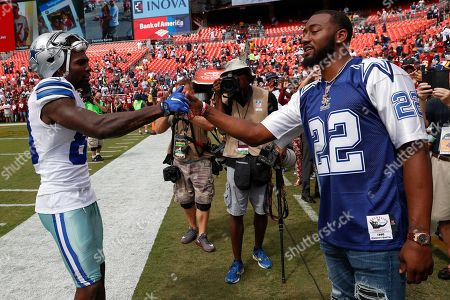 John Wall, Dez Bryant. Dallas Cowboys wide receiver Dez Bryant (88) greets Washington Wizards point guard John Wall before an NFL football game against the Washington Redskins in Landover, Md