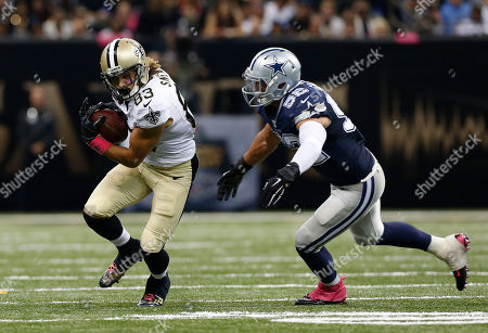 Stock Photo of Willie Snead, Andrew Gachkar. New Orleans Saints wide receiver Willie Snead (83) carries against Dallas Cowboys linebacker Andrew Gachkar (52) in the second half of an NFL football game in New Orleans