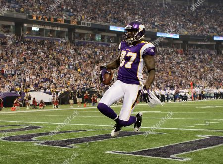 Minnesota Vikings wide receiver Bernard Berrian reacts after scoring a touchdown during the first half of an NFL preseason football game against the Dallas Cowboys, in Minneapolis