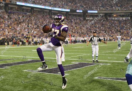 Minnesota Vikings receiver Bernard Berrian celebrates a touchdown during the first half of an NFL preseason football game against the Dallas Cowboys, in Minneapolis