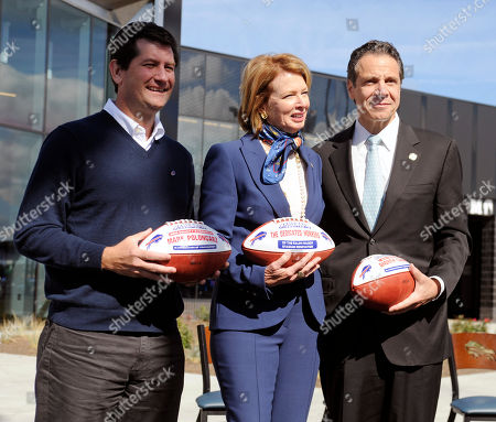 Mark Poloncarz,Mary Wilson,Andrew Cuomo. Erie County Executive Mark Poloncarz, left, Mary Wilson, wife of the late Buffalo Bills owner Ralph Wilson, and New York Gov. Andrew Cuomo pose with footballs during a ribbon cutting ceremony for renovations to Ralph Wilson Stadium before of an NFL football game between the Bills and the Miami Dolphins, in Orchard Park, N.Y