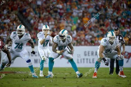 John Jerry, Mike Pouncey, Nate Garner, Ryan Tannehill. Miami Dolphins guard John Jerry (74), center, Mike Pouncey (51) and guard Nate Garner (75) set up to block as quarterback Ryan Tannehill (17) takes the snap during the second half of an NFL football game against the Tampa Bay Buccaneers in Tampa, Fla